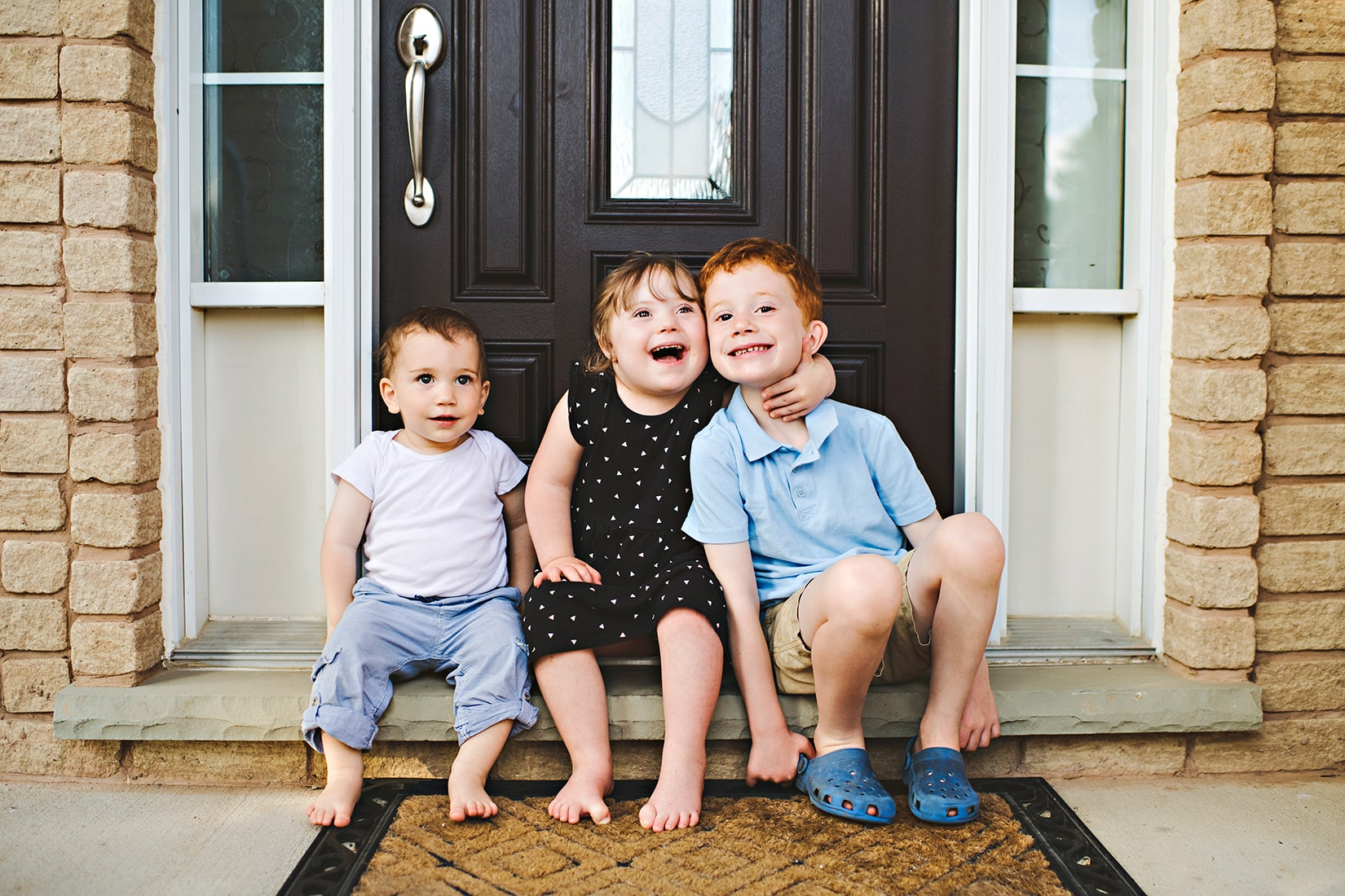 Young kids on doorstep