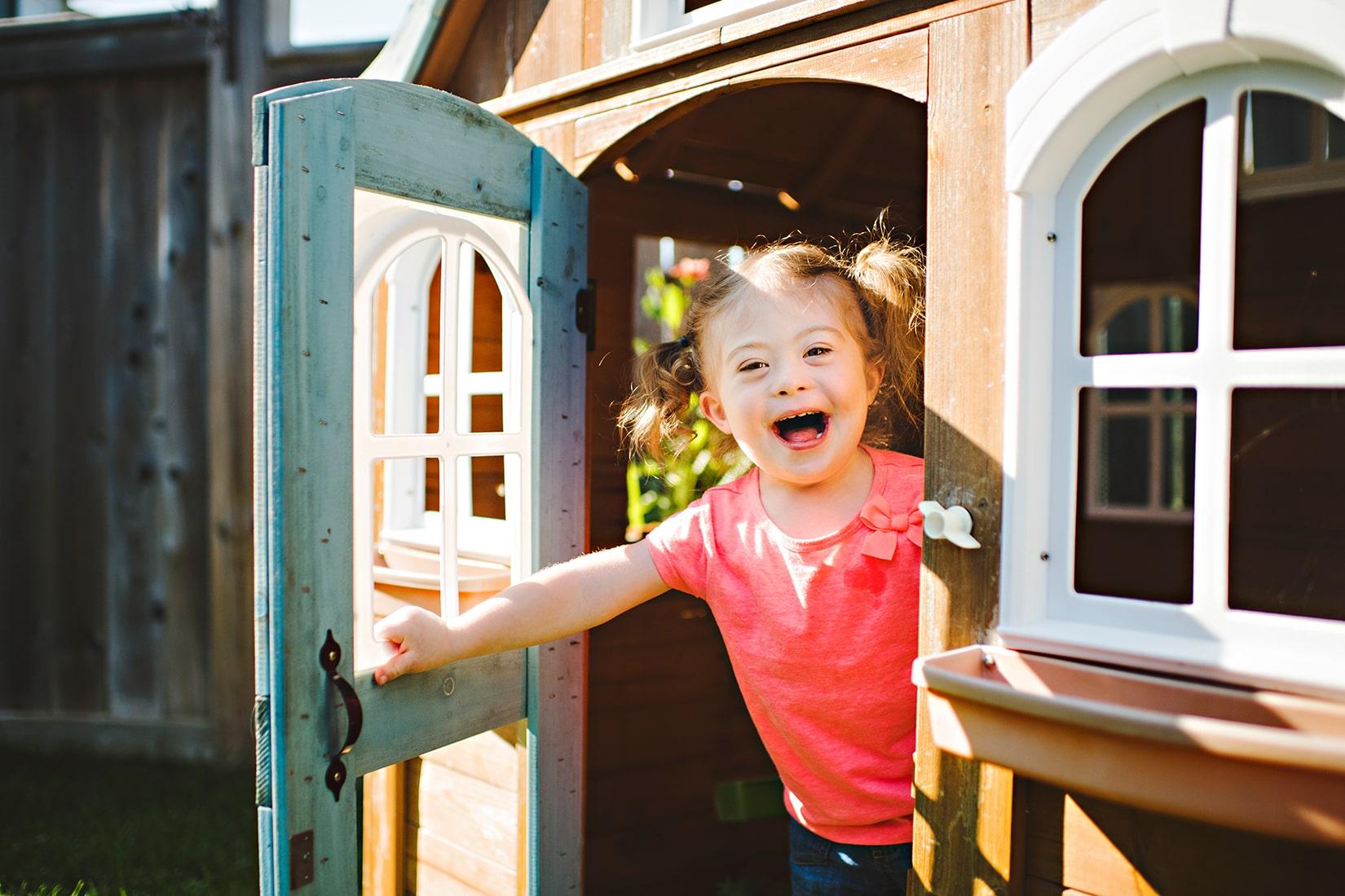 Girl in playhouse